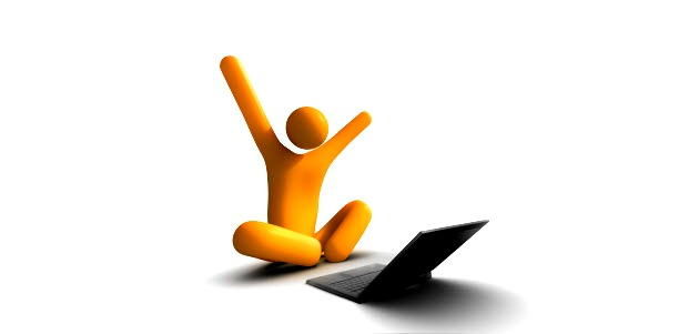 happy web user infront of laptop
